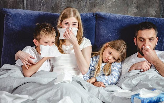 Family sick in bed with colds